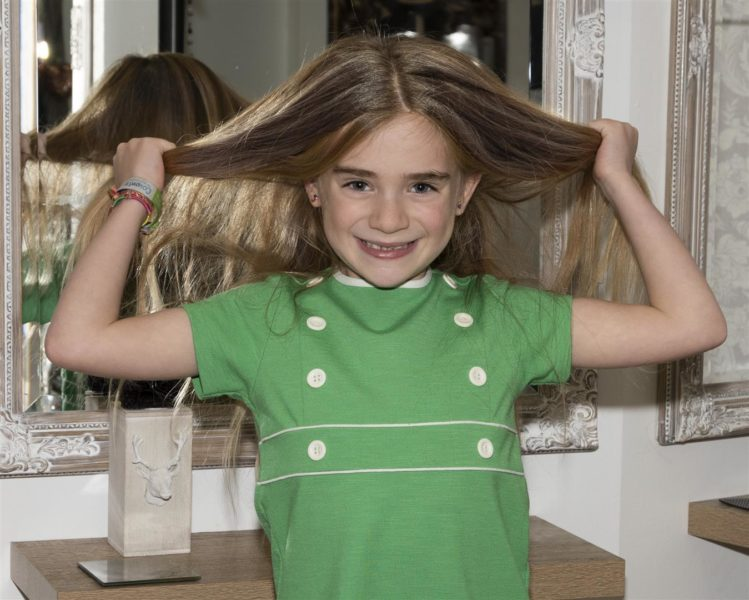 Hope-Davis-about-to-donate-her-hair-to-the-Little-Princess-Trust.-Photo-Tysalls-Photography
