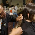 Long hair being cut by a barber