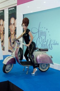 Amy Childs straddling an Italian