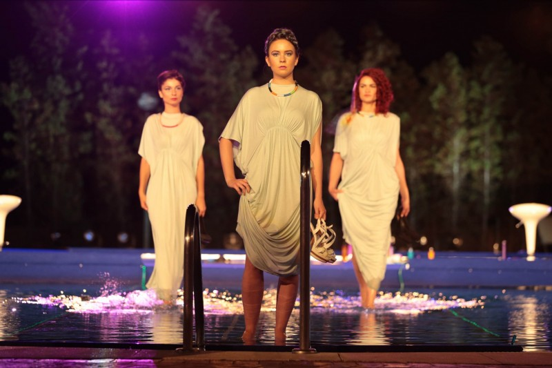 underwater catwalk with models appearing to glide across the surface